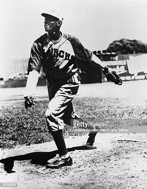 Leroy Satchel Paige of the Negro League Kansas City Monarchs pitches Paige played for the Kansas City Monarchs from 19391947 In this era of his long...