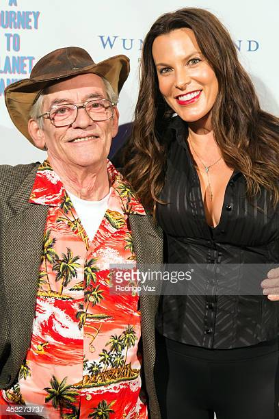 LeRoy Tessina and producer Danielle Crane attend 'A Journey To Planet Sanity' Los Angeles Premiere at Laemmle Monica 4Plex on December 2 2013 in...