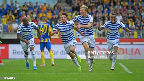 LeroyJacques Mickels Moritz Stoppelkamp Vincent Vermeij and Yassin Ben Balla of Duisburg celebrate their teams third goal during the 3 Liga match...