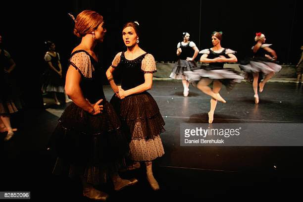 Les Ballets Trockadero de Monte Carlo performers take a break after a practice performance as they wait for feedback from the director on September...