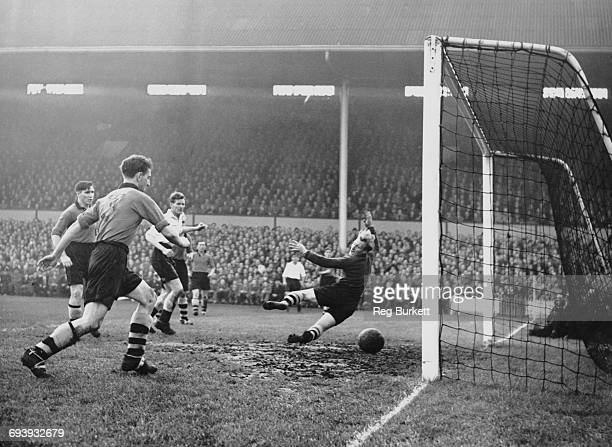 Les Bennett of Spurs shoots the ball past Wolverhampton Wanderers goalkeeper Bert Williams to score as Wolves defenders Roy Pritchard number 3 and...