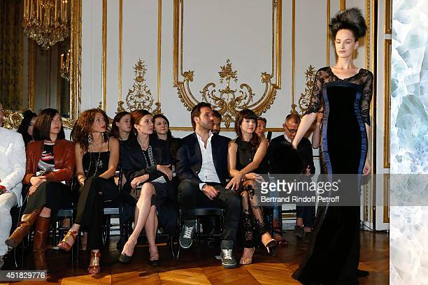 Les Brigitte Sylvie Hoarau and Aurelie Saada Christophe Michalak and Delphine McCarty attend the Alexis Mabille show as part of Paris Fashion Week...