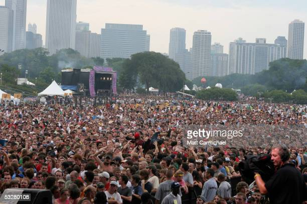Les Claypool performs with Primus live in front of a large crowd in concert at Lollapalooza 2005 day one July 23 2005 in Chicago Illinois
