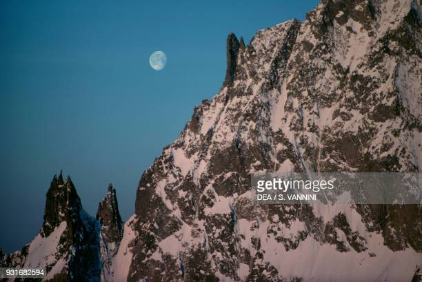 Les Dames des Anglaises at sunset with the moon in the sky seen from Torino refuge Mont Blanc massif Graian Alps Aosta Valley Italy