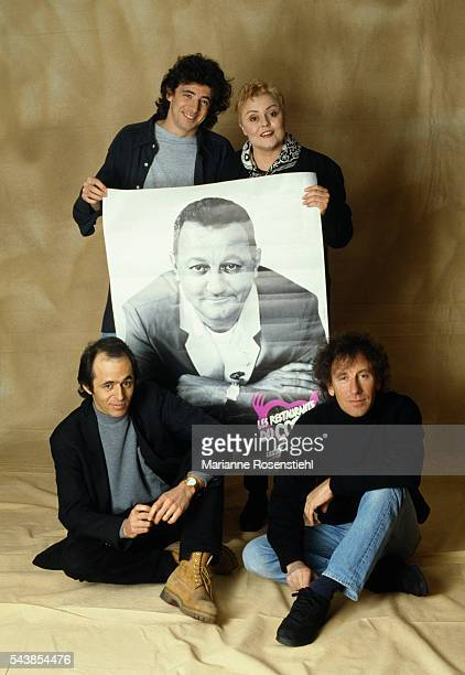 Les Enfoirés composed of French singer Patrick Bruel humorist Muriel Robin singers and songwriters JeanJacques Goldman and Alain Souchon display a...