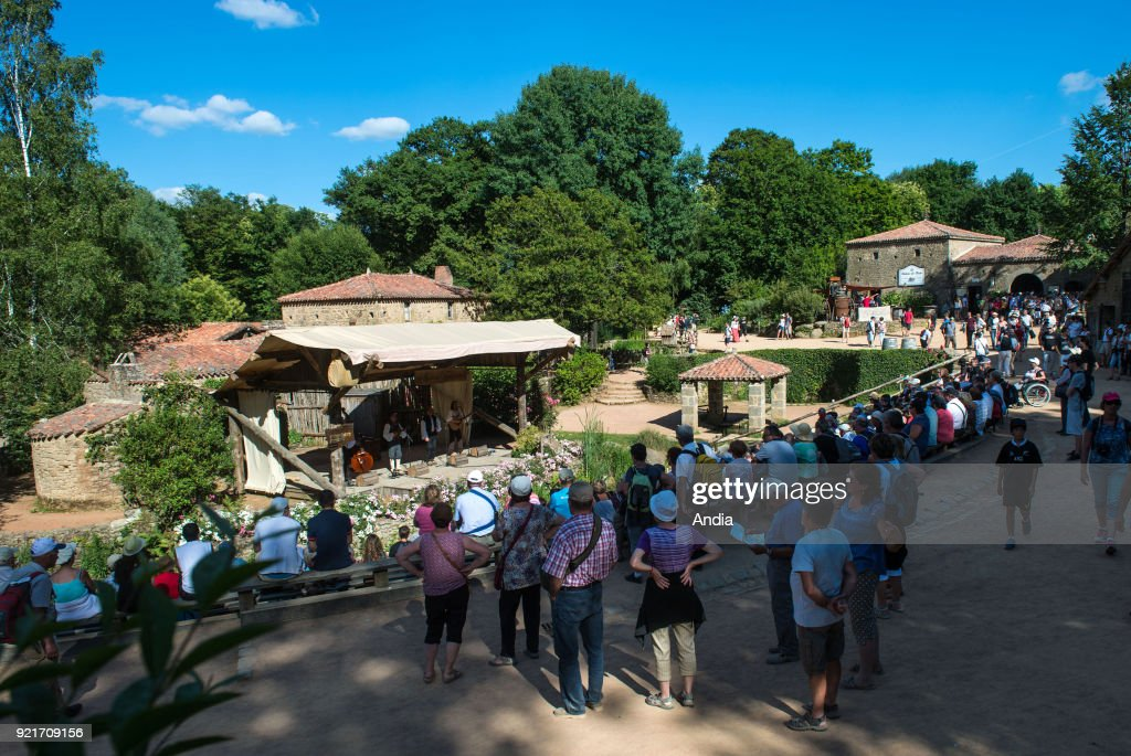 Les Epesses (central-western France). Historical theme park 'Puy du Fou'. . Atmosphere in the park. Spectators visiting the village dating back to the XVIIIth century.