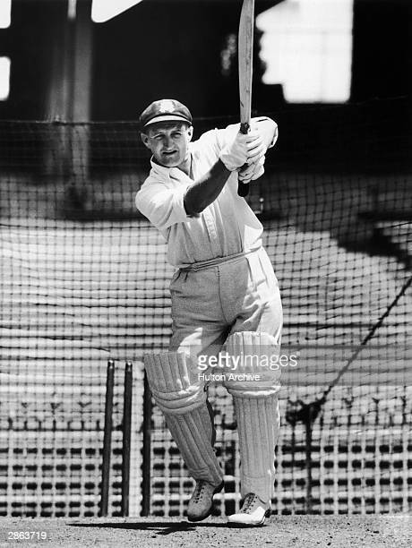 Les Favell of Australia hits out during a net session prior to the first test between Australia and England held on November 25 1954 at the Brisbane...