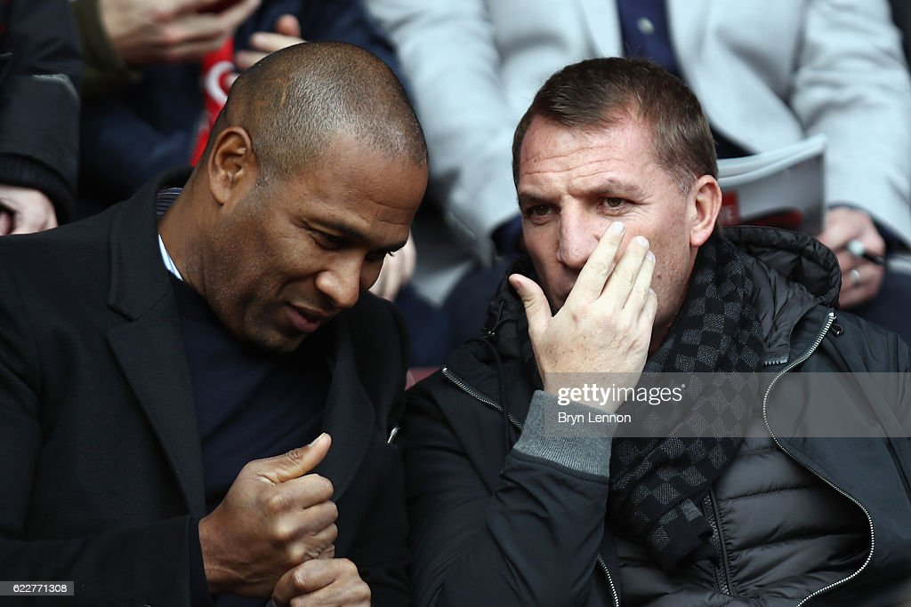 Les Ferdinand (l) chats to Brendan Rogers prior to the Sky Bet League One match between Swindon Town and Charlton Athletic at County Ground on November 12, 2016 in Swindon, England.