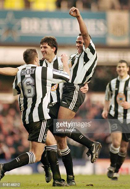 Les Ferdinand is lifted up by Phillipe Albert and Steve Howey as Rob Lee looks on as Ferdinand celebrates the first goal in the 2-0 win over...