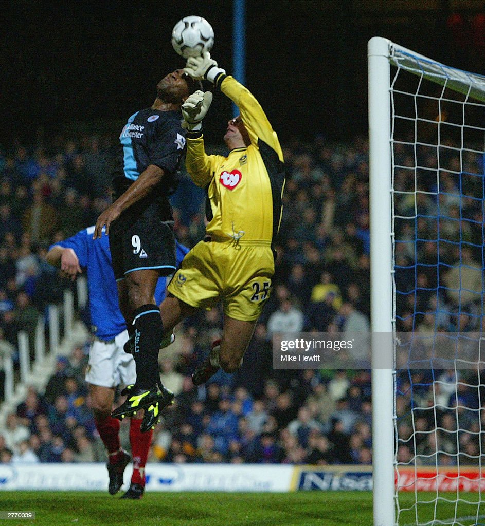 Les Ferdinand of Leicester City challenges Harald Wapenaar of Portsmouth during the FA Barclaycard Premiership match between Portsmouth and Leicester City at Fratton Park on November 29, 2003 in Portsmouth, England.