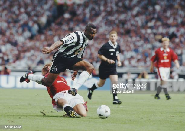 Les Ferdinand of Newcastle United evades the tackle of Phil Neville of Manchester United during their FA Charity Shield game on 11th August 1996 at...