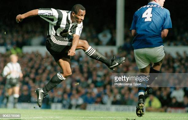 Les Ferdinand of Newcastle United scores the 1st goal as David Unsworth of Everton attemps to block during an FA Carling Premiership match at...