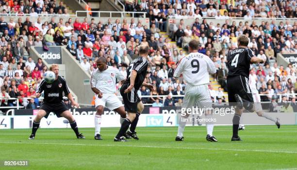 Les Ferdinand scores Englands first goal during the England v Germany charity match in aid of the Bobby Robson Foundation at St James' Park on July...