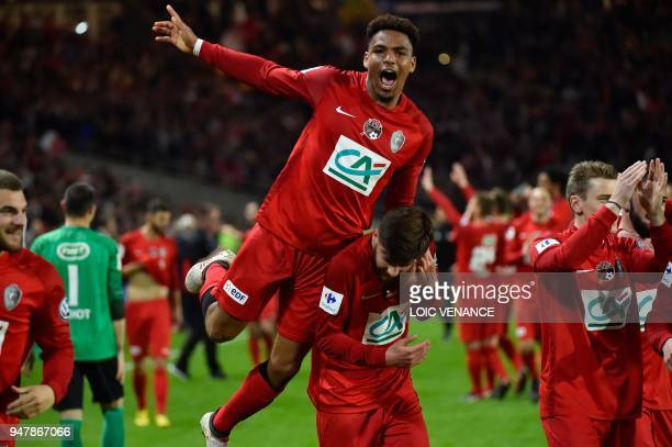 TOPSHOT Les Herbiers' Ambroise Gboho celebrates with teammates after winning the French cup semifinal match between Les Herbiers and Chambly at The...