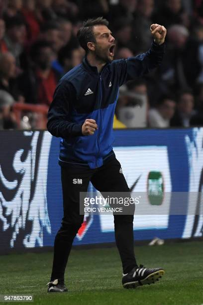 Les Herbiers' coach Stephane Masala gestures from the touchline during the French cup semifinal match between Les Herbiers and Chambly at The...