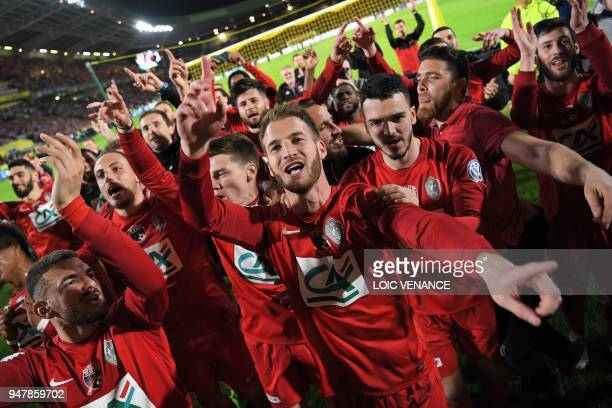 Les Herbier's footballer Franck Héry celebrates with teammates after winning the French cup semifinal match between Les Herbiers and Chambly at The...