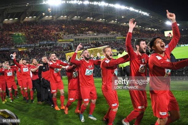 Les Herbier's footballers celebrate after winning the French cup semifinal match between Les Herbiers and Chambly at The Beaujoire Stadium in Nantes...