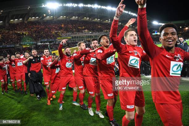 TOPSHOT Les Herbier's footballers celebrate after winning the French cup semifinal match between Les Herbiers and Chambly at The Beaujoire Stadium in...