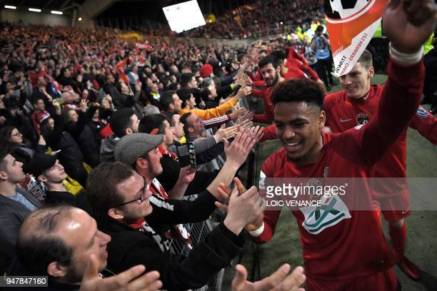 Les Herbier's footballers celebrate with supporters after winning the French cup semifinal match between Les Herbiers and Chambly at The Beaujoire...