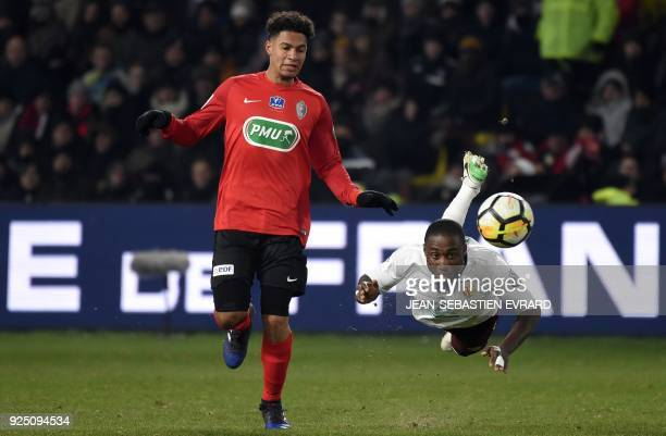 TOPSHOT Les Herbiers' French midfielder Florian David looks on as Lens' Ivorian defender Brice Dja Djeje heads the ball during the French football...
