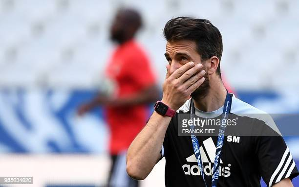 Les Herbiers' headcoach Stephane Masala looks as his players during a training session at the Stade de France in SaintDenis north of Paris on May 7...
