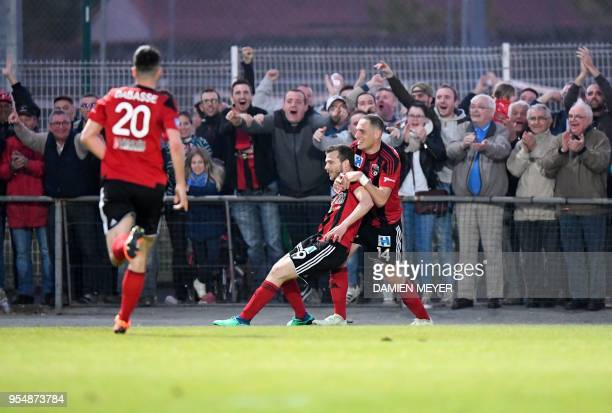 Les Herbiers' midfielder Pierre Germann is congratulated by teammates Clément Couturier and Adrian Dabasse after scoring a goal during the French...