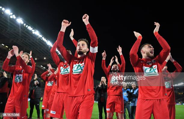 Les Herbier's midfielder Sebastian Flochon defender Adrien Pagerie and teammates celebrate after the French Cup semifinal football match between Les...