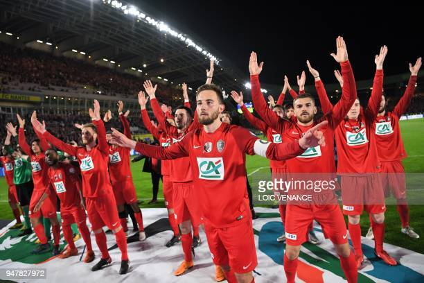 TOPSHOT Les Herbier's midfielder Sebastian Flochon defender Adrien Pagerie and teammates celebrate after the French Cup semifinal football match...