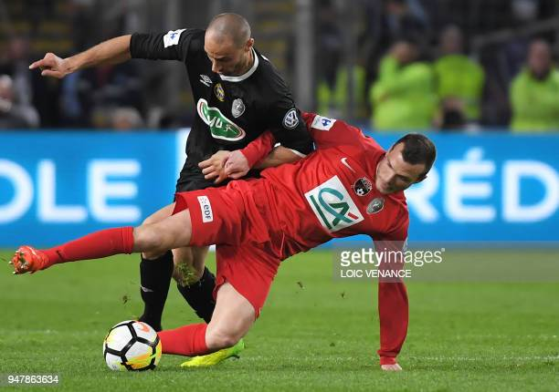 Les Herbiers' Pierre Germain fights for the ball with Chambly's Laurent Heloise during the French cup semifinal match between Les Herbiers and...
