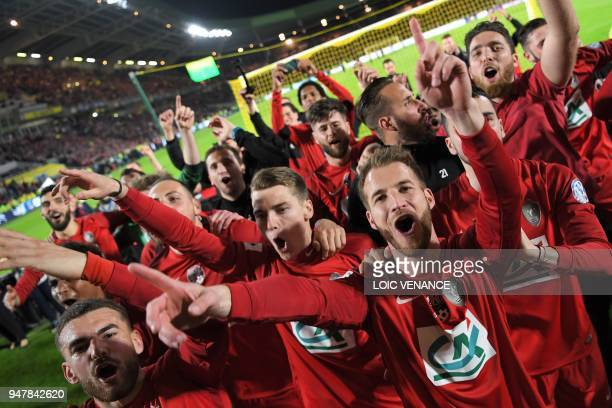 Les Herbier's players celebrate after the French Cup semifinal football match between Les Herbiers and Chambly at the Beaujoire Stadium in Nantes...