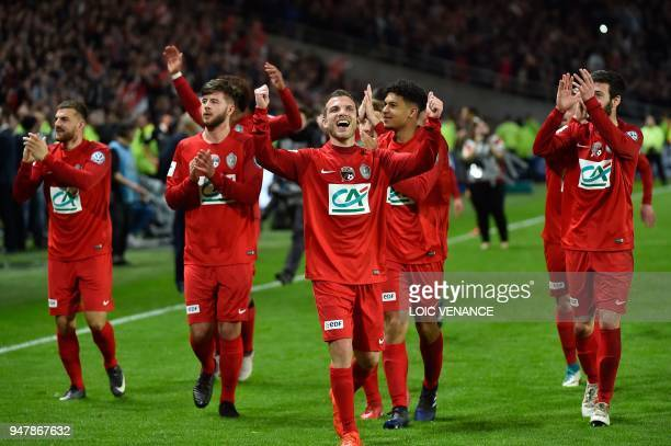 Les Herbiers' players celebrate after winning the French cup semifinal match between Les Herbiers and Chambly at The Beaujoire Stadium in Nantes on...