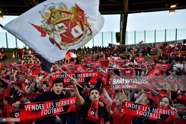 Les Herbiers supporters cheer for their team prior to the French Cup semifinal football match between Les Herbiers and Chambly at the Beaujoire...