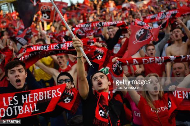 TOPSHOT Les Herbiers supporters cheer for their team prior to the French Cup semifinal football match between Les Herbiers and Chambly at the...