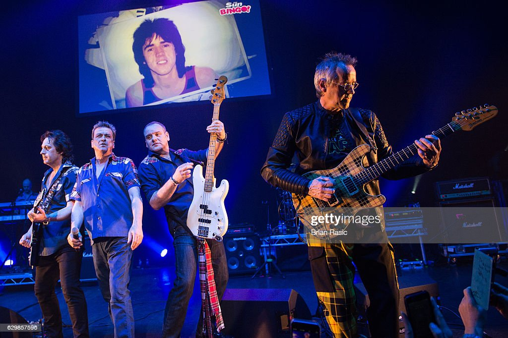 Les McKeown (L) and Stuart John Wood of The Bay City Rollers perform at Eventim Apollo on December 14, 2016 in London, England.