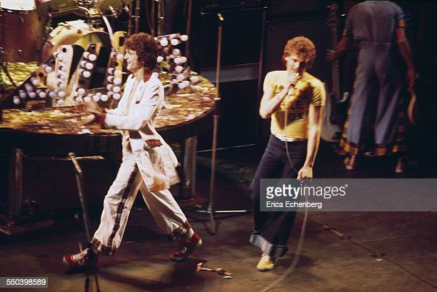 Les McKeown of Bay City Rollers with BBC Radio 1 DJ Peter Powell on stage New Victoria Theatre London United Kingdom 1977