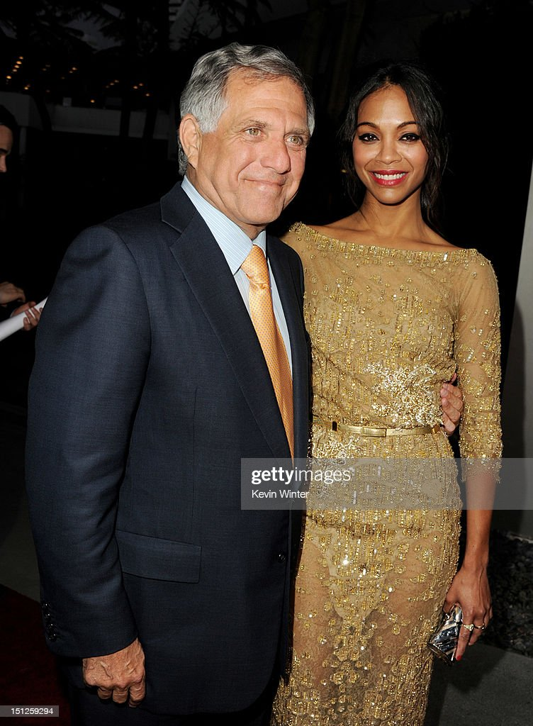 Les Moonves, President and CEO, CBS Corporation (L) and actress Zoe Saldana arrive at the premiere of CBS Films' 'The Words' at the Arclight Theatre on September 4, 2012 in Los Angeles, California.