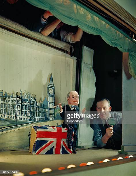 1944 'Les Parcs Marionettes' puppet show with actor Maxim Lloyd speaking into a microphone offstage imitating the voice of Winston Churchill August...
