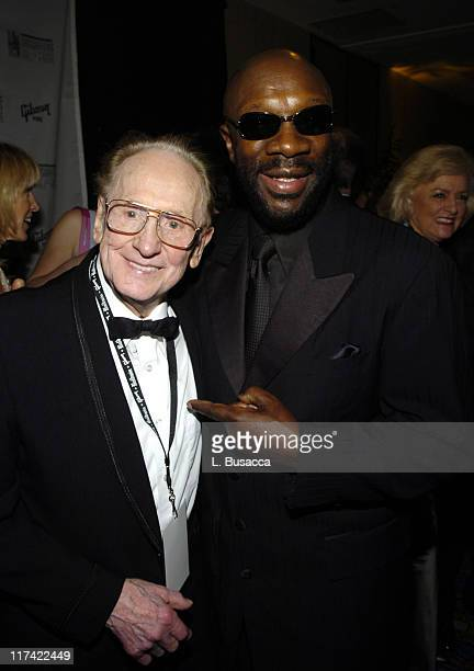 Les Paul and Isaac Hayes during 36th Annual Songwriters Hall of Fame Induction Ceremony VIP Cocktail Reception at Marriott Marquis Hotel in New York...