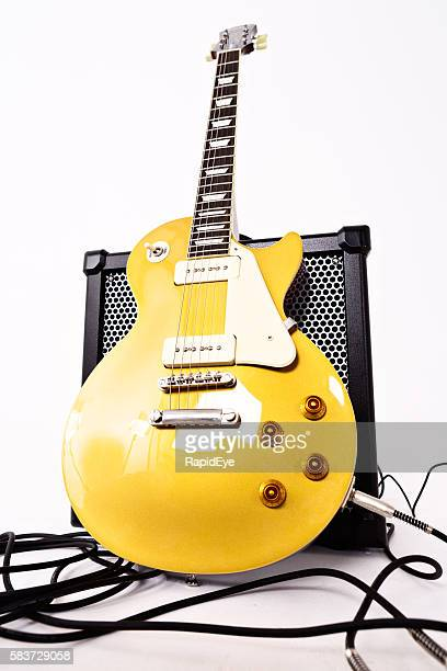Les Paul Pro electric guitar, goldtop finish, with Roland amplifier