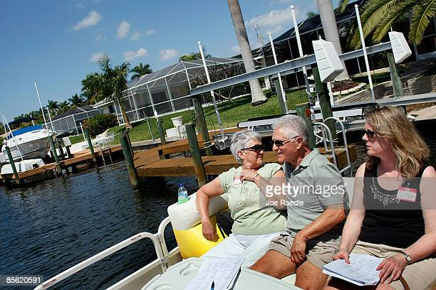 Les Renkey and Colleen Christman along with other prospective buyers take part in a foreclosure boat tour by Foreclosures 'R Us realty company on...