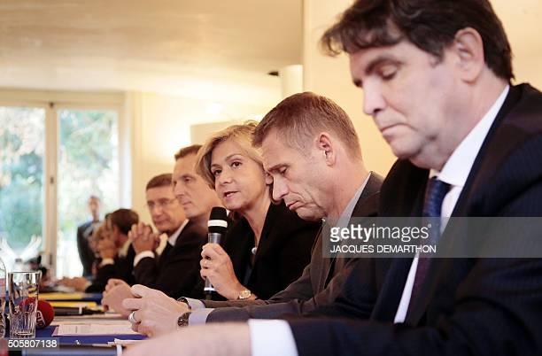 Les Republicains' member and president of the regional council of the Ile-de-France region Valerie Pecresse, flanked by delegate Thierry Meignen ,...