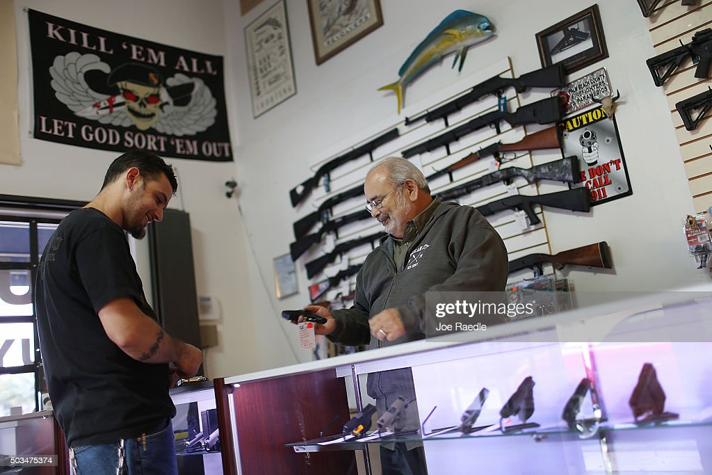 Les Wexler (R) helps Jason Fenlon as he shops for a handgun at the K&W Gunworks store on the day that U.S. President Barack Obama in Washington, DC announced his executive action on guns on January 5, 2016 in Delray Beach, Florida. President Obama announced several measures that he says are intended to advance his gun safety agenda.