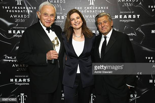 Les Wexner Abigail Wexner and Ed Razek pose backstage at the 2016 Fragrance Foundation Awards presented by Hearst Magazines Show on June 7 2016 in...