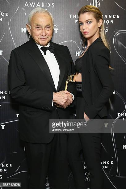 Les Wexner and Stella Maxwell pose at the 2016 Fragrance Foundation Awards presented by Hearst Magazines Show on June 7 2016 in New York City