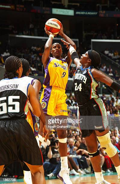 Lesa Leslie of the Los Angeles Sparks puts up a shot over Tari Phillips of the New York Liberty during the first half of action in game 2 of the2002...