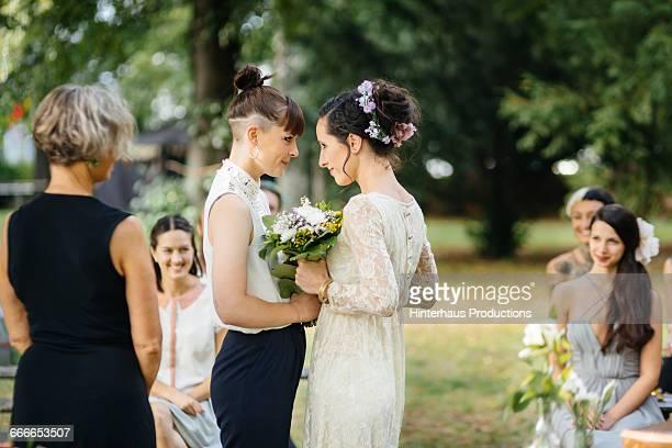 Lesbian couple at wedding ceremony