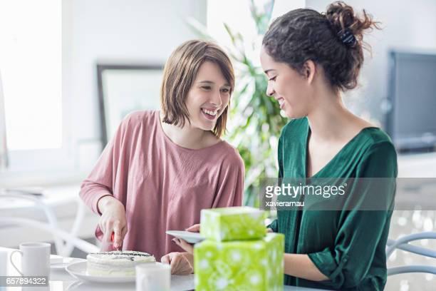 Lesbian couple celebrating birthday at home