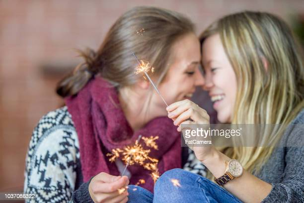 Lesbian couple celebrating New Years with sparklers