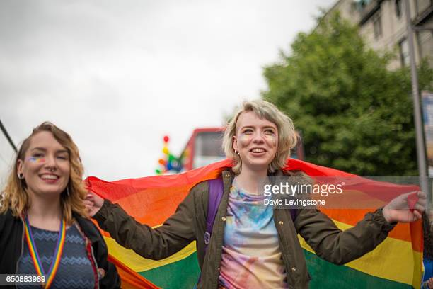 lesbian couple celebrating pride - lgbtqi pride event stock pictures, royalty-free photos & images