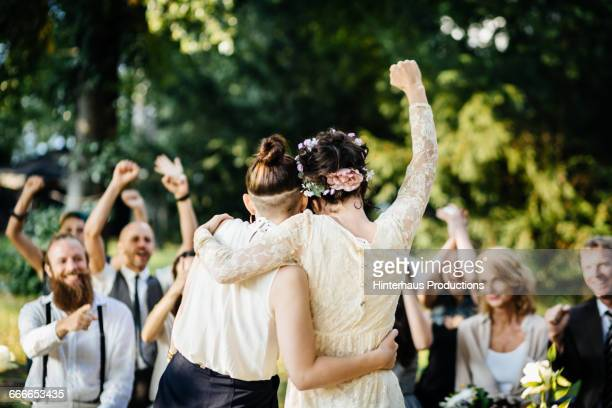lesbian couple celebrating their marriage - trouwen stockfoto's en -beelden